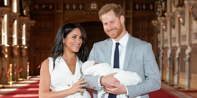 Britain's Prince Harry and Meghan, Duchess of Sussex, during a photocall with their newborn son, in St George's Hall at Windsor Castle, Windsor, south England, on May 8, 2019.  (Dominic Lipinski/Pool via AP)