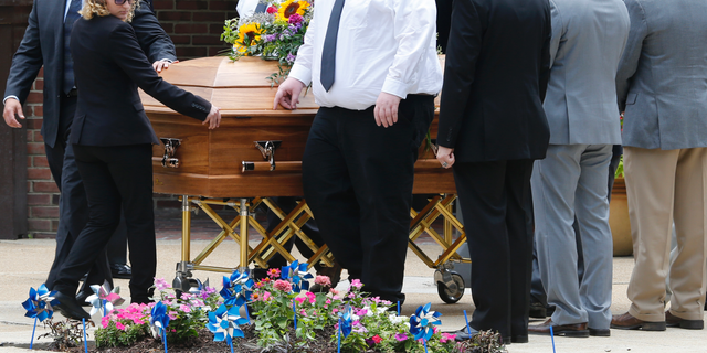The casket of Virginia Beach shooting victim Katherine Nixon is wheeled to a hearse after a funeral service at St. Gregory The Great Catholic Church in Virginia Beach, Va Thursday, June 6, 2019. Nixon was killed along with eleven others during a mass shooting last Friday. (AP Photo/Steve Helber)