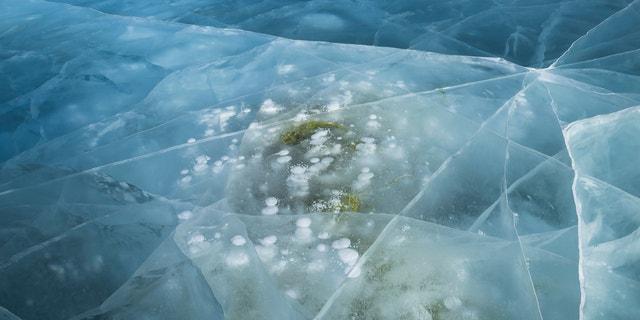 Frozen bubbles of methane locked beneath Lake Baikal.