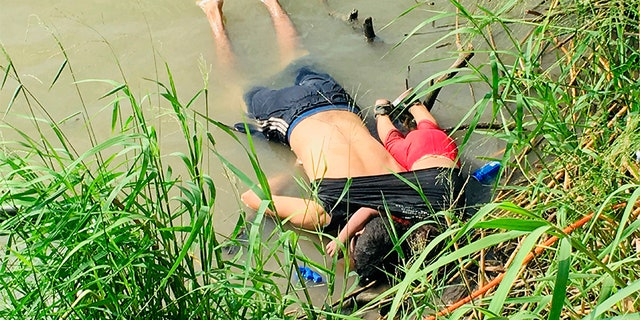 The bodies of Salvadoran migrant Oscar Alberto Martínez Ramirez and his nearly 2-year-old daughter Valeria lie on the Rio Grande River in Matamoros, Mexico, on Monday. (AP)