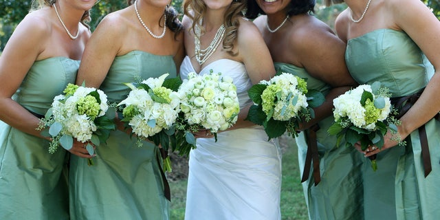 Forty-three percent of maids of honor and 38 percent of best men polled said that their special role required them to spend more than they had.