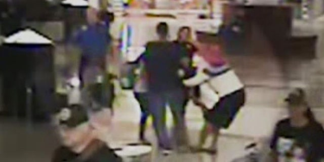 Horror video shows woman trying to kidnap two children at airport