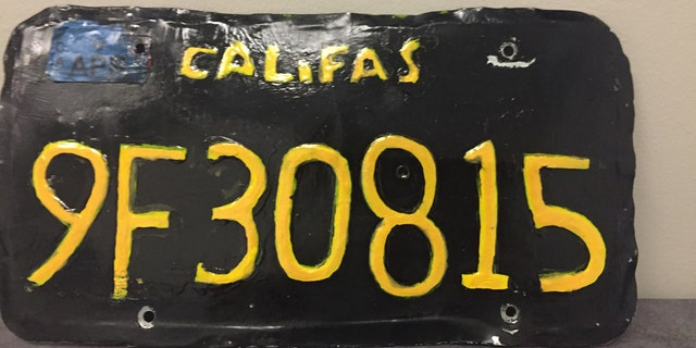 "A fake license plate that read ""Califas"" with black background with yellow lettering that caught the attention of a motorcycle officer."