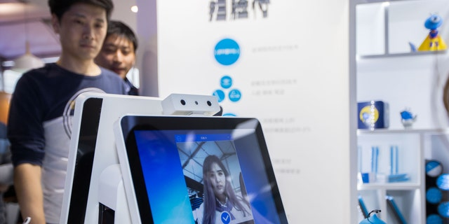 The mechanism works on a facial approval during a Ant Financial counter forward of 2016 The Computing Conference during Yunqi Cloud Town on Oct 12, 2016 in Hangzhou, Zhejiang Province of China.