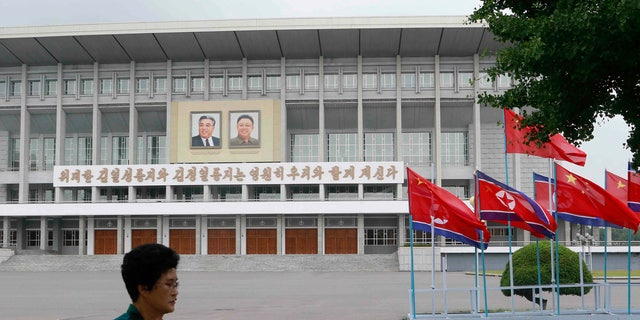 North Korean and Chinese national flags are hoisted on a street in Pyongyang, North Korea Thursday, June 20, 2019. Chinese President Xi Jinping arrived Thursday morning for a two-day state visit to North Korea, where he is expected to talk with leader Kim Jong Un about the stalled negotiations with Washington over North Korea's nuclear weapons.