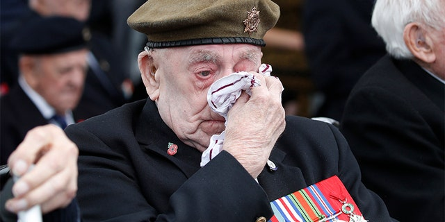 A veteran wipes his eyes during a ceremony to mark the 75th anniversary of D-Day, in Portsmouth, England. (AP)