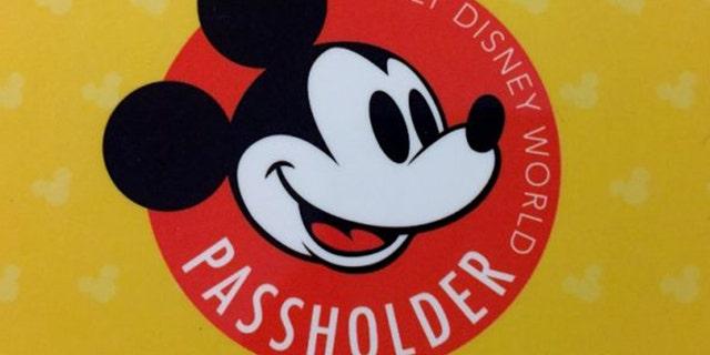 An image of a Walt Disney World annual park pass card.