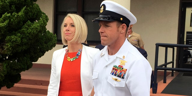 Navy Special Operations Chief Edward Gallagher leaves a military courtroom on Naval Base San Diego with his wife, Andrea Gallagher in San Diego.