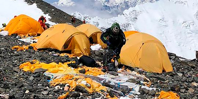 This May 2019, photo provided by climber Dawa Steven Sherpa shows Camp Four, the highest camp on Mount Everest littered with abandoned tents.