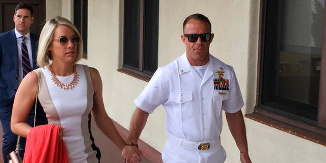 Navy Special Operations Chief Edward Gallagher, right, walks with his wife, Andrea Gallagher as they arrive to military court on Naval Base San Diego. (AP Photo/Julie Watson)