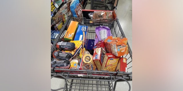 """Officer James Riley purchased groceries for a local family after he said they appeared to be """"going through difficult financial times."""""""