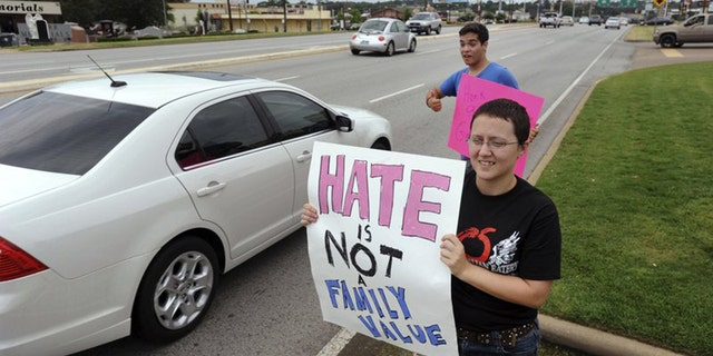 Texans holding signs ancillary happy matrimony outward of a Chick-fil-A in Tyler, in 2012.