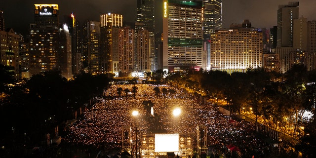 Many thousands of people attend a candlelight vigil for victims of the Chinese government's brutal military crackdown three decades ago on protesters in Beijing's Tiananmen Square at Victoria Park in Hong Kong Tuesday, June 4, 2019.