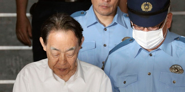 Hideaki Kumazawa, left, a former top Japanese government official,has been arrested in his son's killing and media reports say the retired bureaucrat told investigators he had feared his reclusive son might harm others.