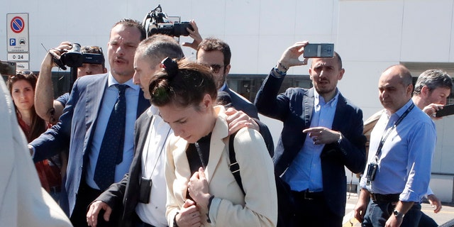 Amanda Knox is approached by a journalist upon her arrival in Linate airport Milan Italy Thursday