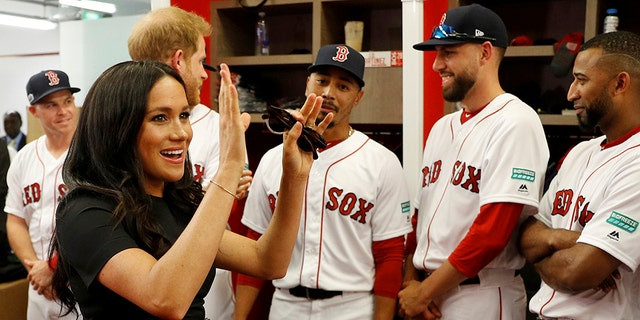 Britain's Prince Harry and Meghan, Duchess of Sussex meet Boston Red Sox players before a match against the New York Yankees in London.