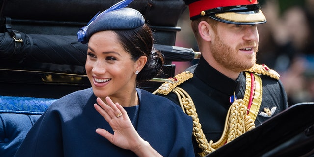 Prince Harry, Duke of Sussex and Meghan, Duchess of Sussex float by carriage down a Mall during Trooping The Colour, a Queen's annual birthday parade, on Jun 8, 2019, in London. (Photo by Samir Hussein/Samir Hussein/WireImage)
