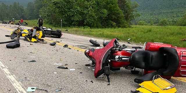 This photo provided by Miranda Thompson shows the scene where several motorcycles and a pickup truck collided on a rural, two-lane highway Friday, in Randolph, N.H. (AP/Miranda Thompson)