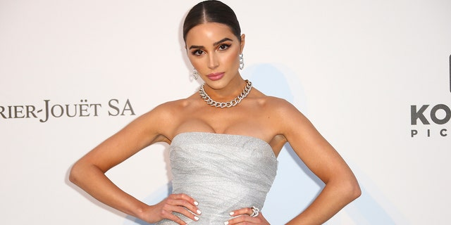 Olivia Culpo displays her toned figure in white swimsuit while on vacation: 'Bikini spam' - Fox News