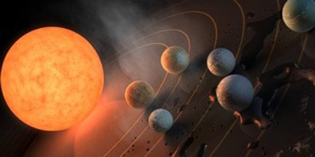 Three planets orbiting TRAPPIST-1 tumble within that star's habitable zone. (Credit: R. Hurt/ NASA/JPL-Caltech/)