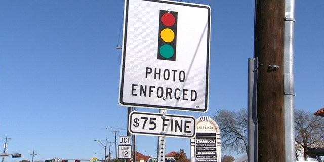 Texas Gov. Greg Abbott signed a bill on Saturday night that red light cameras across the state.