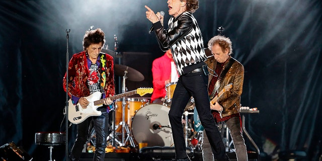 Ronnie Wood, Mick Jagger and Keith Richards of the Rolling Stones perform as they resume their performance.