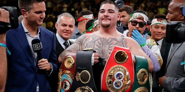 Andy Ruiz poses for photographs after a heavyweight title boxing match against Anthony Joshua. (AP)