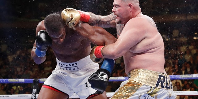 Andy Ruiz, right, punches Anthony Joshua during the seventh round of a heavyweight championship boxing match. (AP)