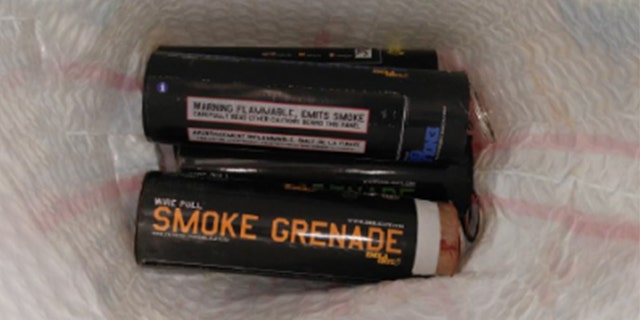 An image of the smoke grenades found in a man's carry-on bag at NewarkLiberty International Airport on Sunday.