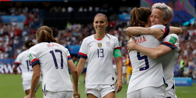 United States' Megan Rapinoe, right, celebrates with teammates after scoring her team's first goal during the Women's World Cup quarterfinal soccer match between France and the United States at Parc des Princes in Paris, France, Friday, June 28, 2019. (AP Photo/Alessandra Tarantino)