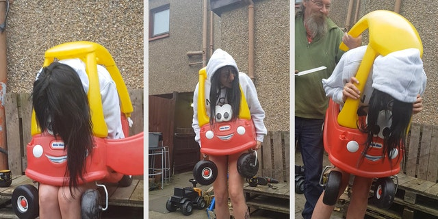 Zoe Archibald managed to get stuck in the children's toy car during a family gathering on Friday.