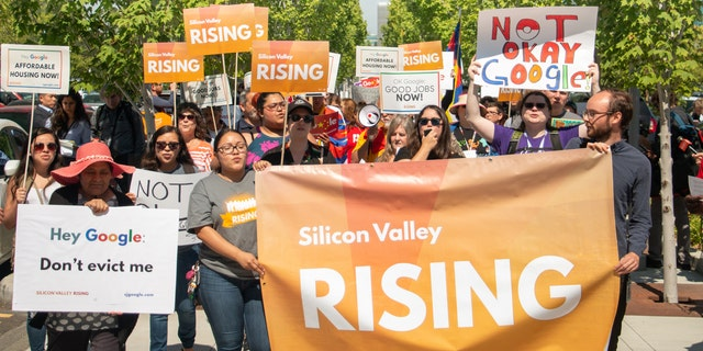 A bloc of romantic groups, shareholders and employees demonstrated outward Google's domicile in Mountain View, California, this week.