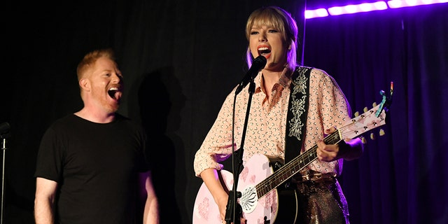Jesse Tyler Ferguson (L) and Taylor Swift perform at AEG and Stonewall Inns pride celebration commemorating the 50th anniversary of the Stonewall Uprising.