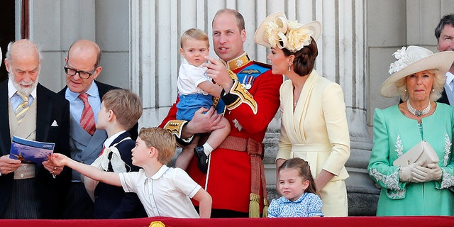 Britain's Prince William and Kate, a Duchess of Cambridge with their Prince George, core left, Princess Charlotte, core right, and Prince Louis, tip center, attend a annual Trooping a Colour Ceremony
