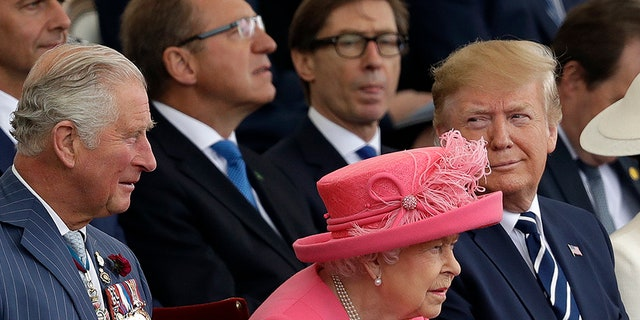 Britain's Queen Elizabeth II, sits in-between President Donald Trump and Prince Charles as they attend an event to mark the 75th anniversary of D-Day in Portsmouth, England Wednesday, June 5, 2019.