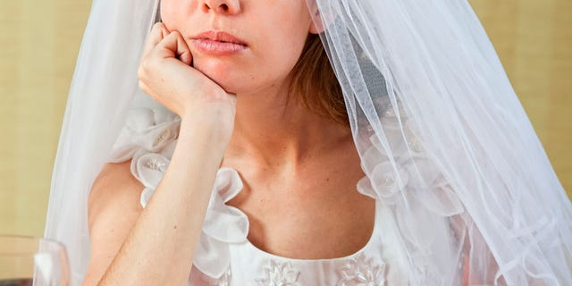 The groom asked her if she had anything to change into. That's when she noticed the bride staring daggers at her.