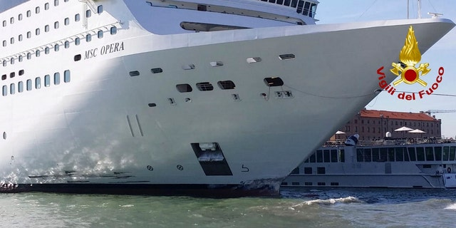 The MSC Opera cruise liner stand by a tourist boat following a collision in Venice, Italy, Sunday, June 2, 2019.