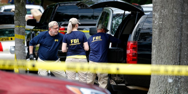 Police said the investigation is ongoing for a possible motive for the deadly rampage that killed 12 people and left several others injured Friday. (AP)