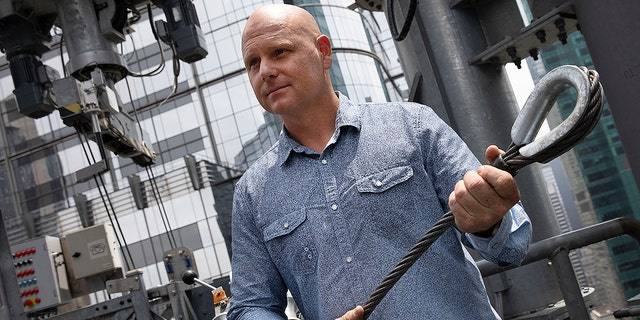 Aerialist Nik Wallenda talks with the media about his planned high-wire act, Thursday, June 20, 2019 in New York. Wallenda and his sister Lijana will cross Times Square on a high wire on Sunday. He is holding a cable similar to the one that will stretch across the square.