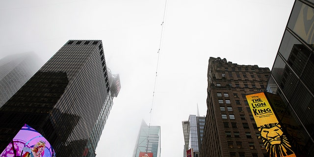 A high-wire crosses Times Square, Thursday, June 20, 2019 in New York. Performers Nik and Lijana Wallenda will cross Times Square on the high wire on Sunday.