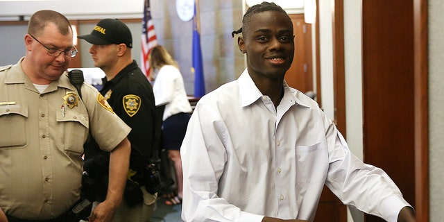 """Weslie Martin, accused of burglarizing Wayne Newton's home, is escorted out of the courtroom following his hearing at the Regional Justice Center in Las Vegas, Friday, June 21, 2019. A Nevada jury found martin, a 22-year-old state prison inmate guilty of burglarizing the mansion of """"Mr. Las Vegas"""" entertainer Wayne Newton twice in June 2018, and of trying to break into a neighboring home."""