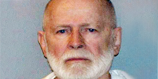 "FILE - This June 23, 2011, file booking photo provided by the U.S. Marshals Service shows James ""Whitey"" Bulger. Officials with the Federal Bureau of Prisons said Bulger died Tuesday, Oct. 30, 2018, in a West Virginia prison after being sentenced in 2013 in Boston to spend the rest of his life in prison."