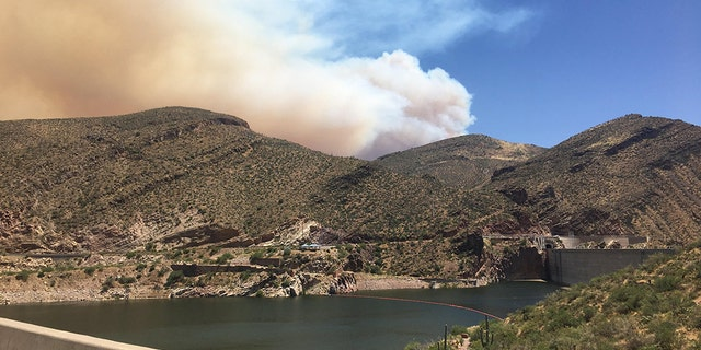 The Woodbury Fire began on June 8 in the Tonto National Forest near Roosevelt Lake and has since forced the evacuation of about 700 homes as the human-caused wildfire has grown over 100 square miles.