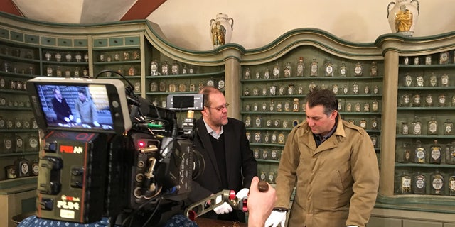 Inside the German Pharmacy Museum, James Holland meets with medical historian, Dr. Peter Steinkamp of Ulm University. (Credit: Courtesy of Brave Planet Films)