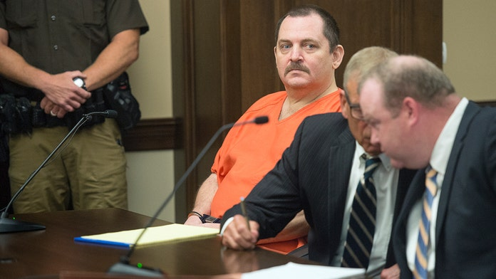 Nebraska woman's accused killer slashes his neck in courtroom horror: reports