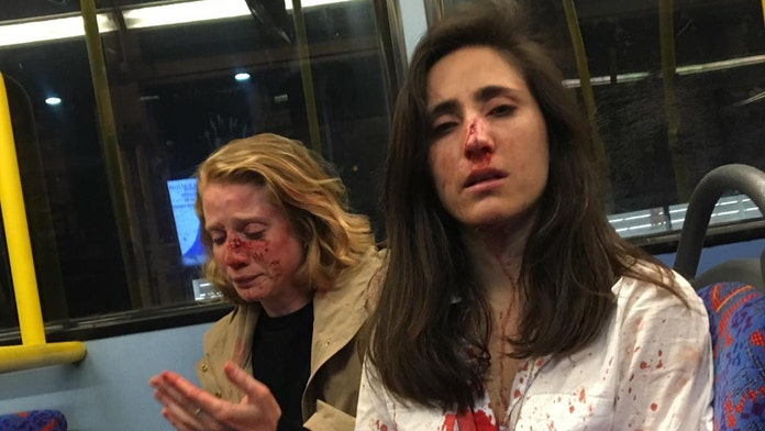 Flight attendant and American girlfriend attacked by gang of men on London bus after refusing to kiss