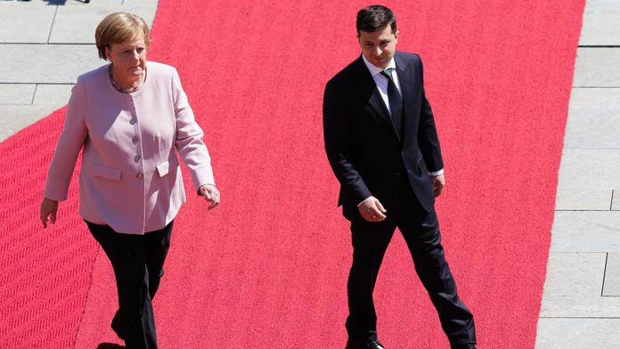 The Latest: Germany's Merkel blames dehydration for shaking