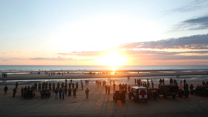 The Latest: Normandy crowds want to preserve D-Day memories