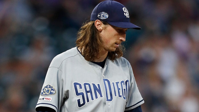 San Diego Padres pitcher says he was ejected after cheering on teammate