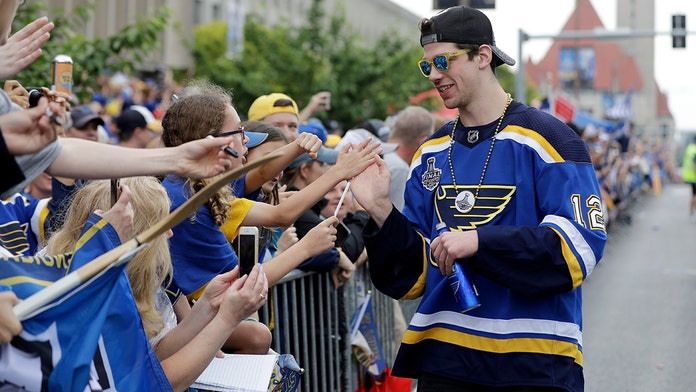 St. Louis Blues' Zach Sanford appears to puke on himself during victory parade
